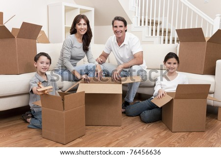 Family, parents, son and daughter, unpacking boxes and moving into a new home.