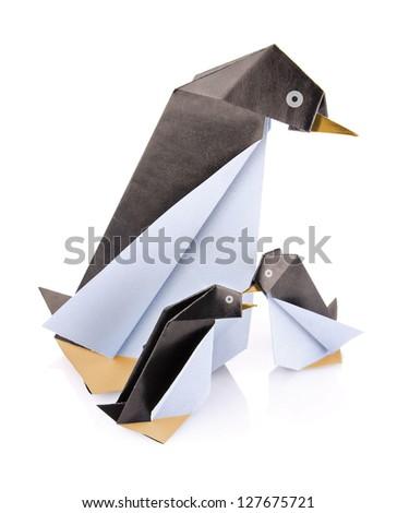 family penguin origami isolated on white background