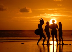 family photo shilouette  of sunset at Parangtritis beach