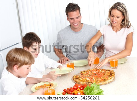 Family pizza . Father, mother and children eating a big pizza