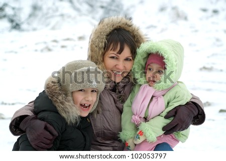family playing against the backdrop of the snow