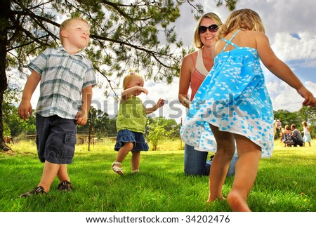 Family playing in the grass at a horse farm