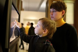 Family playing with touch screen in a museum