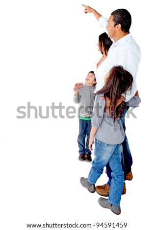 Family pointing at a blank space to edit - isolated over a white background