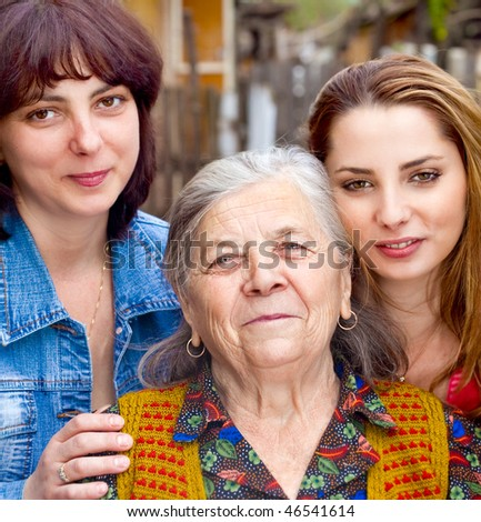Family portrait - cute daughter granddaughter and grandmother