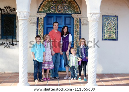 Family portrait in front of a home