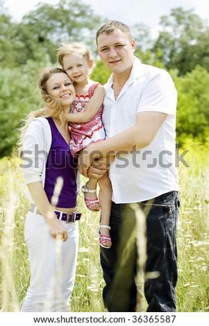 Family portrait in the meadow.
