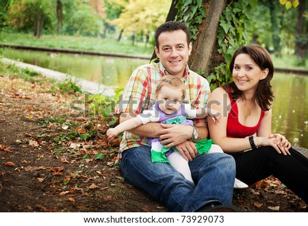 Family portrait - mother father and baby daughter outdoor