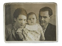 Family portrait of a young couple with a child, an old picture