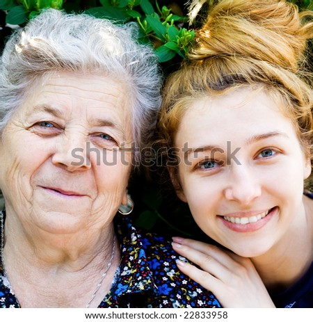 Family Portrait of Happy Old Grandmother and Young Daughter