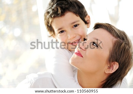 Family portrait of mother and son at home