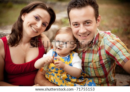 Family portrait - parents and their little cute girl
