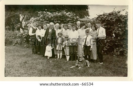 Family portrait, people of all ages, circa 1925.