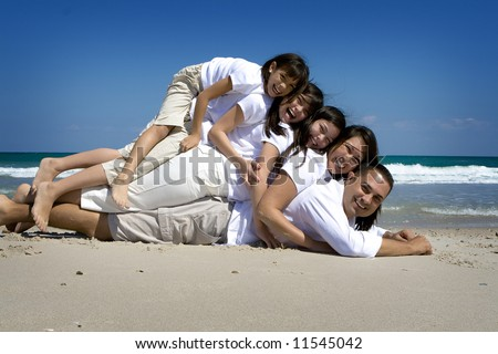 Family pose at the beach