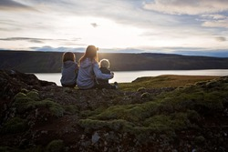 Family posing in Geothermal area in Reykjanesfolkvangur, enjoying the view of a splendid nature in Iceland, autumntime