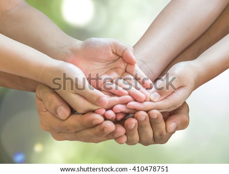 Family prayer hands in empty open palm gesture praying together isolated on green natural bokeh background with clipping path: Father support daughter son spiritual pray for peace of mind CSR concept