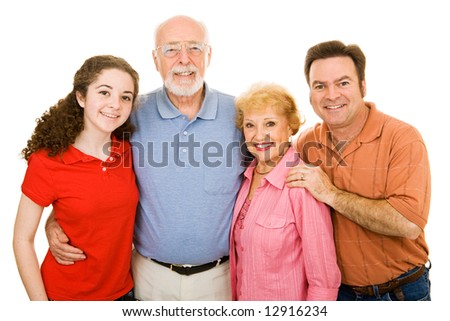 Family ranging in age from teen to seniors, isolated on white background.