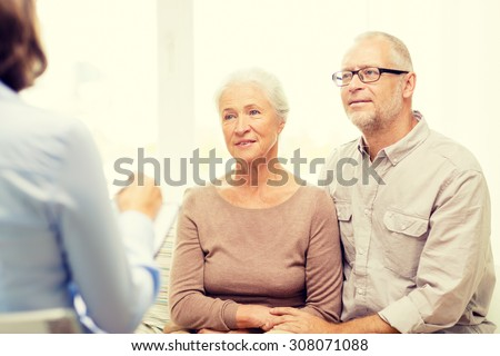 family, relations, age and people concept - happy senior couple and psychologist or social worker at home