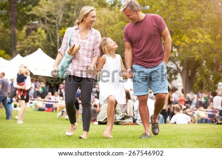 Family Relaxing At Outdoor Summer Event #267546902