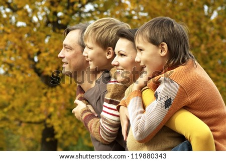 family relaxing in a beautiful autumn park