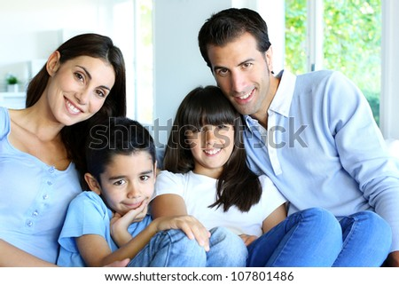 Family relaxing in sofa at home