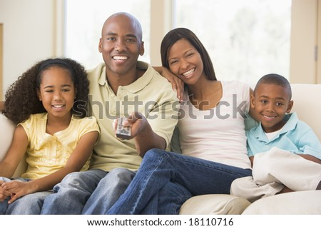 family relaxing watching television at home