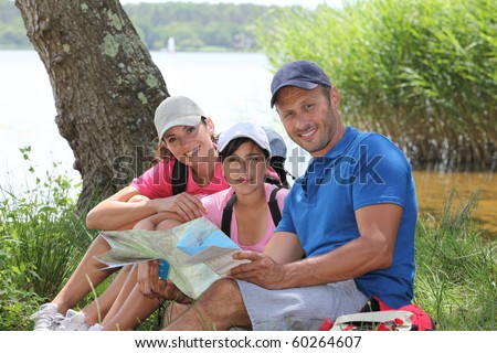 Family resting in the grass on a hiking day