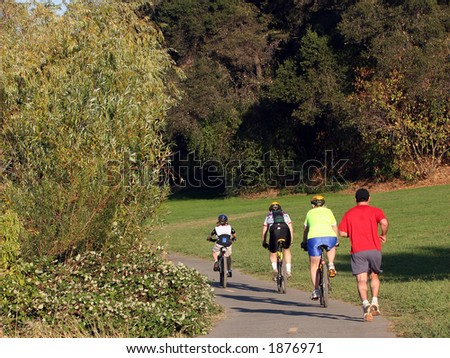 Family riding bikes in a park