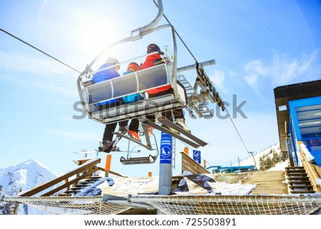 Family Riding In The Ski Lift #725503891