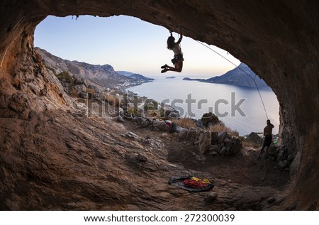 Family rock climber against picturesque view of Telendos Island at sunset. Kalymnos Island, Greece