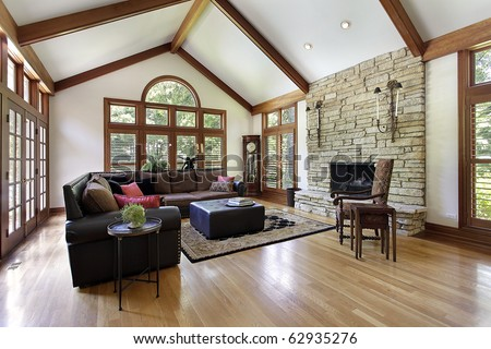 Family Room In Luxury Home With Stone Fireplace Stock