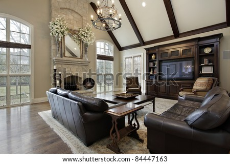 Sala dos Professores Stock-photo-family-room-in-luxury-home-with-two-story-stone-fireplace-84447163
