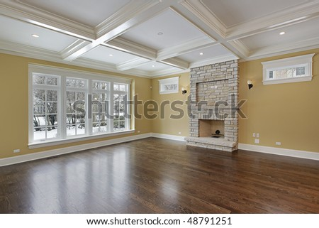 Family room in new construction home with stone fireplace for New construction fireplace