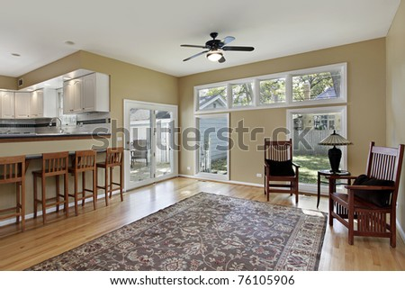Family room in suburban home with doors to deck #76105906