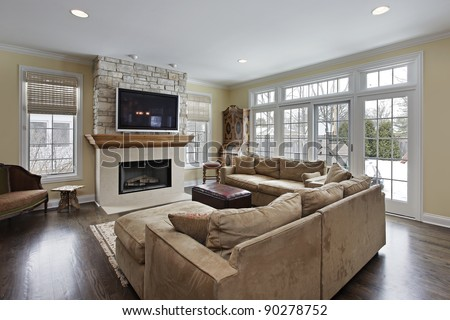 Family room with wood and stone fireplace