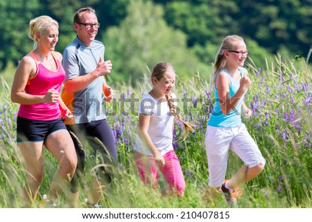 Family running for better fitness in summer through beautiful landscape #210407815