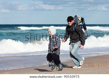 Family running on beach #90510973
