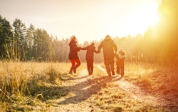 family running on country road in autumn time