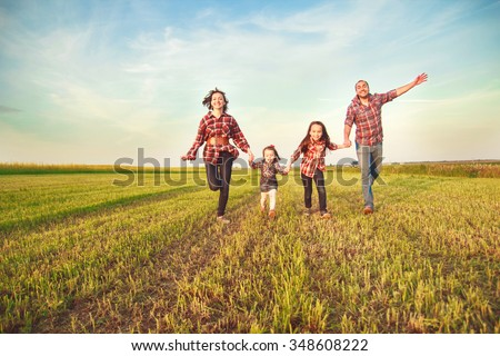 family running together in the field  #348608222