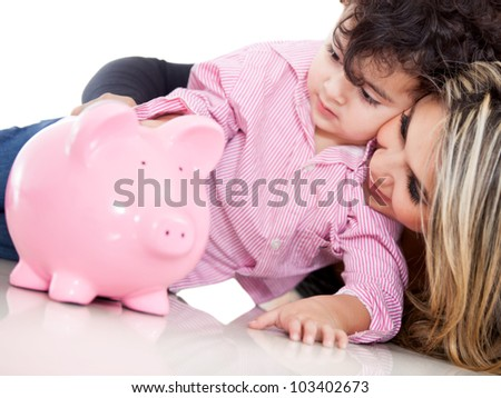 Family saving in a piggybank - isolated over white