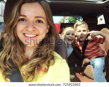 Family selfie photo in car during summer vacation