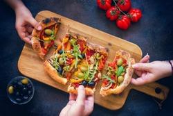 Family sharing fresh homemade vegetarian pizza
