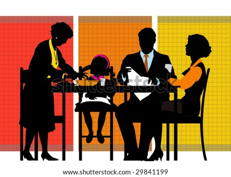 family sitting at the table during the meal