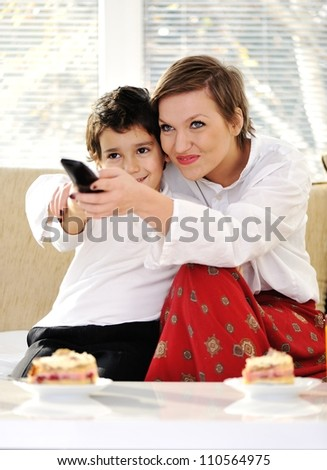 Family sitting in living room with remote control