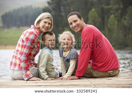 Family sitting on a jetty