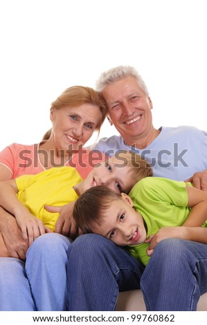 Family sitting on a white background and smiles