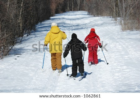 family skiing on trail