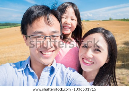 family smile and selfie happily in Hokkaido paddy