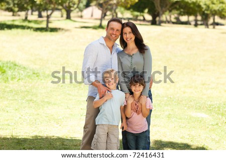 Family standing in the park