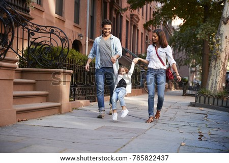 Family taking a walk down the street #785822437